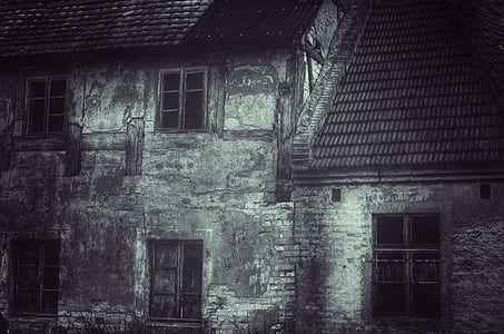 grayscale photography of concrete 2-storey house