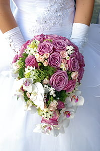close up photo of person holding bouquet