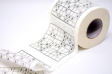 white and black Sudoku-printed tissue paper