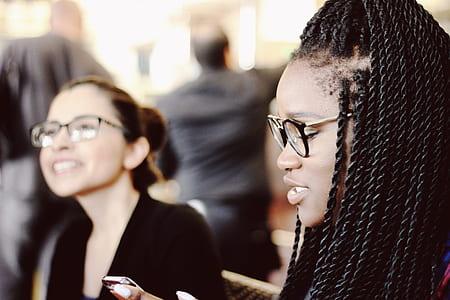braided hair woman in black framed eyeglasses
