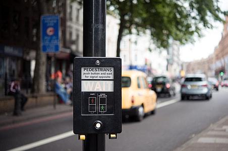 turned on black pedestrian parking meter