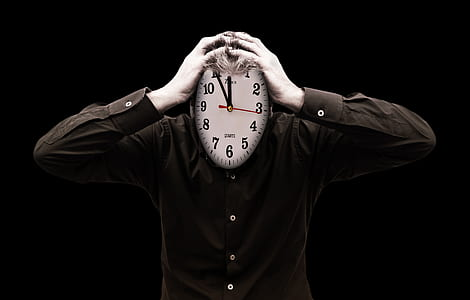 person holding wall clock