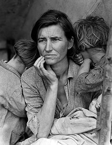 grayscale photo of a woman with her children
