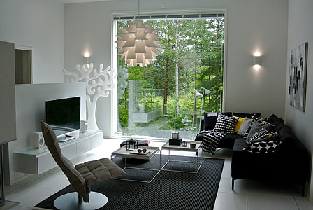 black fabric sectional sofa beside the clear glass window