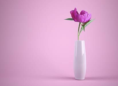 still life photography of purple petaled flower in white ceramic vase