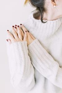 Woman Wearing Turtleneck Sweater in White Surface
