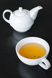Afternoon black tea in a white teapot