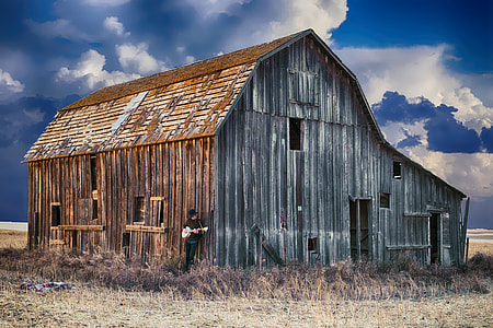 brown wooden barn on cloudy day