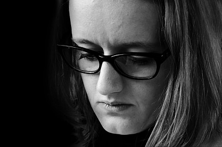 grayscale photo of woman's profile in eyeglasses