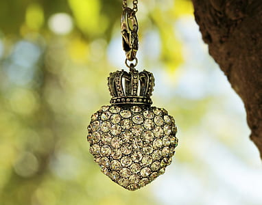macro photography clear gemstone encrusted heart pendant