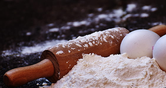 rolling pin with two eggs and flour
