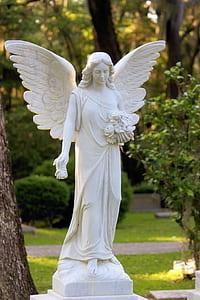 female angel statue in garden