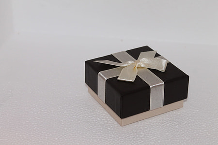 black and gray box with bow