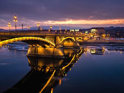 bridge over water near cityscape