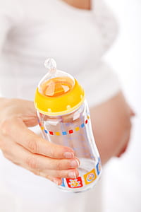 shallow focus of yellow feeding bottle