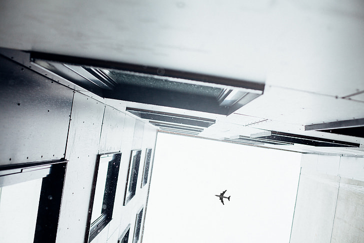 low angle and architectural photography of buildings and airplane