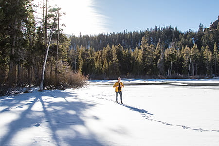 man standing on snow field during daytime
