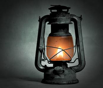 selective photography of kerosene lantern