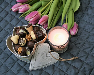 purple tulips and assorted chocolates