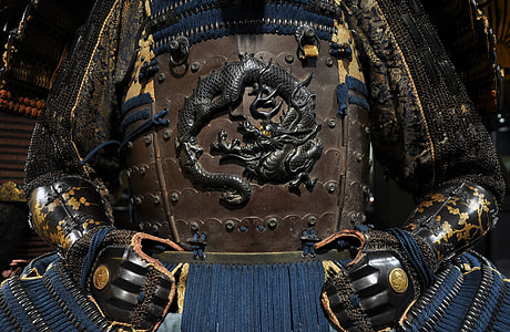 brown, blue, black, and yellow samurai armor with dragon embossed