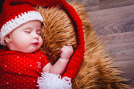 baby wearing red and white knit cap
