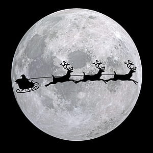 silhouette photo of Santa Claus with three reindeers during full moon