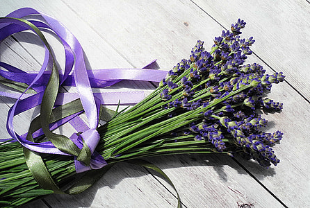 bouquet of lavender flowers on top of gray wooden surface