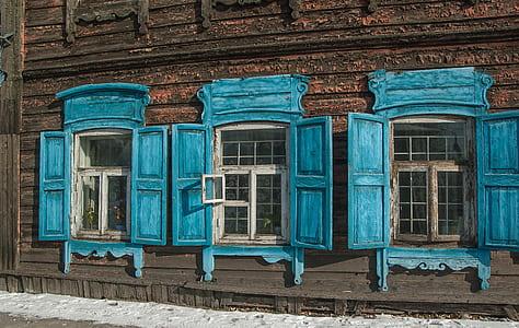three blue wooden windows