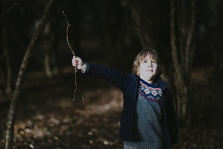 boy holding twig