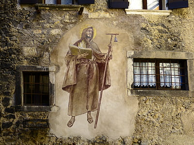man holding staff and book wall mural