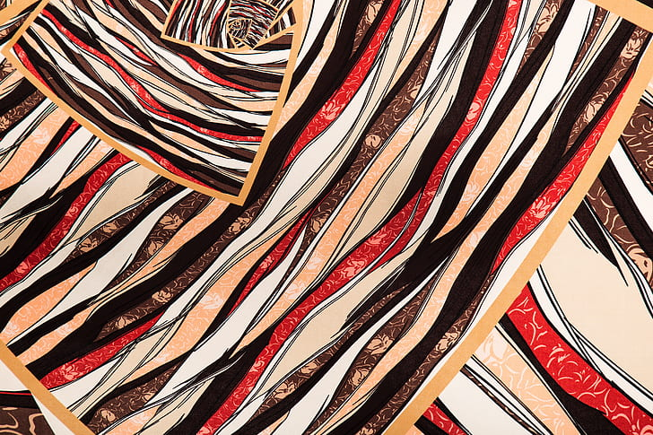 red, brown, and black abstract painting