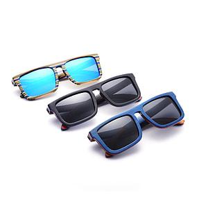 three yellow, black, and blue framed sunglasses