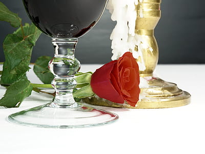red rose near the wine glass