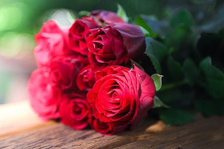 bouquet of rose on brown wooden surface