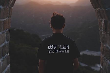 person wearing black Crew Tech crew-neck t-shirt