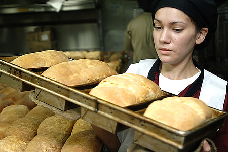 person baking breads