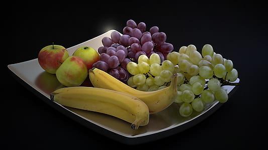 banana, grapes and apples on plate