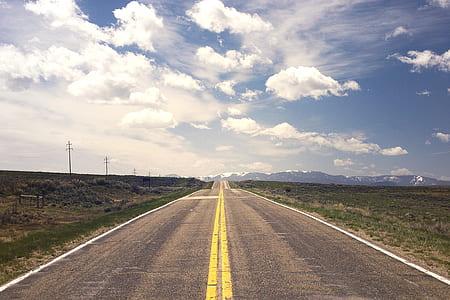concrete road towards mountains