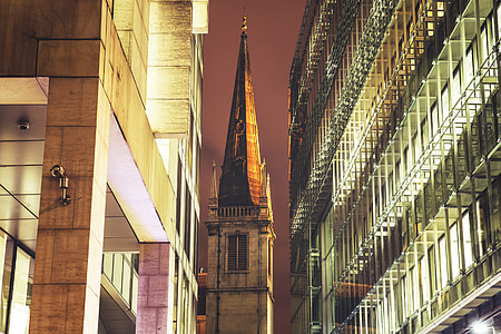 Church spire surrounded by modern buildings in London