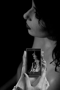 grayscale photo of woman in Nokia Windows smartphone