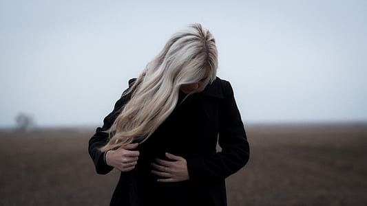 woman with white hair wearing black coat