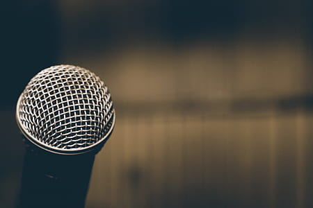 selective focus photography of silver dynamic microphone