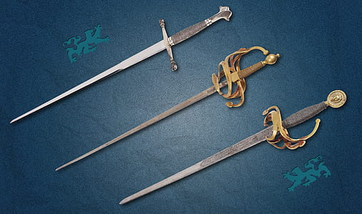 three assorted swords