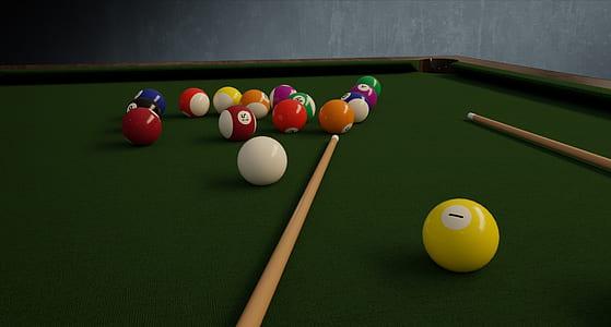 billiard balls and cue sticks on green pool table