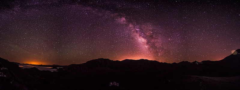 silhouette of mountain during night time