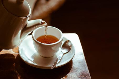 teacup pour with tea