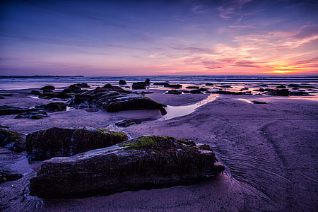 Wide-angle landscape shot taken at sunset on the magnificent coast of Cornwall, England