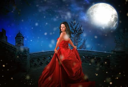 woman wearing red dress on bridge