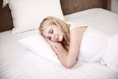 woman sleeping on bed