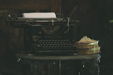 Old typewriter and books on a table